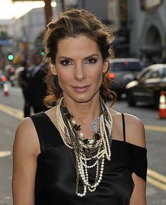 Inspiration to wear a bunch of different necklace together. Sandra Bullock