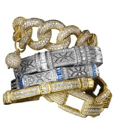 Judith Ripka 18K gold and diamond bracelets...