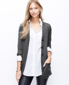 Luxuriously rendered in extrafine merino wool, this wardrobe must sports a longer silhouette and faux leather elbow patches for the height of laid-back luxe. V-neck. Long sleeves. Button front. Faux leather elbow patches. Front pockets. Ribbed cuffs and hem.