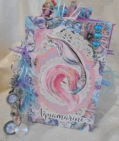 Whimiscal Mermaid Junk Journaaal for a child. This is a sweet journal for my granddaughter Ryanna's 8th birthday. I hope that she will start young, documenting her life. I used Karamfila digital papers and Craft Fantastic charms and glass.   https://www.youtube.com/watch?v=EzJ7hLBu_7A&t=25s