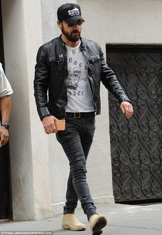 Rocker chic: Justin, 44, kept it edgy in a biker jacket and jeans