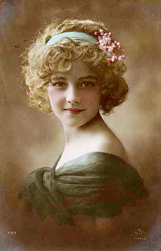 Victorian postcard of a beautiful girl, photo coloured with watercolours