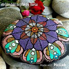 Intricate mandala that's beautifully painted with loads of color!!