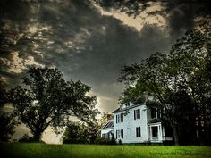 Love this Georgia house pic. A bit Southern Gothic in a way...with the storm rolling in. Nice to be rocking on the front porch here, covered from the rain....