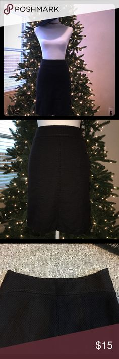 """Ann Taylor Black Skirt Fine Italian Fabric Size 0P Beautiful, great condition, perfect winter boots. Measurements: 25"""" Waist, 19.5"""" Length. Material: 47% cotton, 32% rayon, 21% virgin wool, with lining. Dry clean only. Ann Taylor Skirts"""
