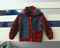 Baby hand knitted hoodie navy with red stripes by SnuggleBubs