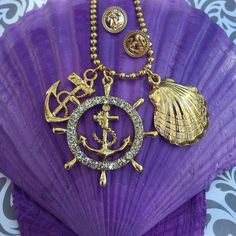 A personal favorite from my Etsy shop https://www.etsy.com/listing/249513231/crystal-seashell-and-anchor-charm