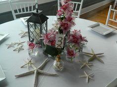 Beach themed wedding reception with cymbidium orchids Reception at Latitude 31 Jekyll Island , Ga