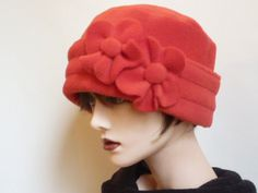 Womens red fleece hat. Warm and comfortable, bright red (like the Elizabeth Arden Red) polar fleece hat for cold days. Size: LARGE - Approx 62cm (24.5) This hat is fully lined and has a turned up brim and can be adjusted to give extra warmth around the ears on windy days. To add decoration, I have stitched to the brim, two matching fabric flower motif. The brim has a stitch detail, which gives a ribbed look to the fabric.    Suitable for all ages and would be a great accessory to have for…