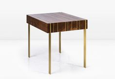 """The ELLIS SIDE TABLE is composed of solid Black Walnut alternating with solid brass which manages a seamless transformation from top surface to leg. Available in other metals and woods.  W 28"""" x D 19"""" x H 21"""""""