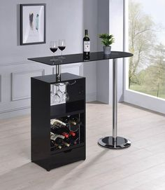 Orren ellis home bar unit modern style black finish bar unit black glass top. This set features a black finish with chrome accents with black tempered glass top and glass and wine racks underneath. Some assembly required. Coaster Furniture, Bar Furniture, Office Furniture, Bar Sala, Built In Wine Rack, Bar Unit, Modern Home Bar, Home Bar Decor, Home Bar Designs