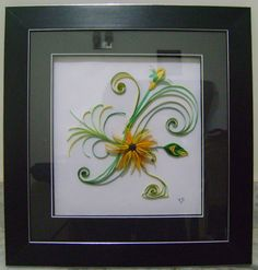 Sunflower design using quilling technique and the picture was framed up..