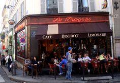 Le Progrès, vigie de Montmartre  Avec ses grandes baies vitrées ouvertes à l'angle de la rue des trois frères et de la rue Yvonne le Tac, c'est mon bar préféré pour surveiller tout ce qui bouge à Montmartre et apprécier le look des passant(e)s. J'aime bien m'asseoir à une des quelques tables en terrasse (enfin plutôt sur le trottoir de la rue Yvonne le Tac) et prendre un café le matin. C'est avant midi que le soleil vient peindre de couleurs vives ce petit bout de Montmartre.  Le Progrès…