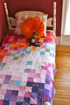 The quilts that cover the kids' beds are made from remnants of their baby clothes. Anna takes on one quilt project every winter.