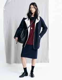 madewell fall 2015 #fallmadewell. shearling-lined navy coat, red striped top, black ankle socks, lace-up oxfords, cross-body bucket bag.