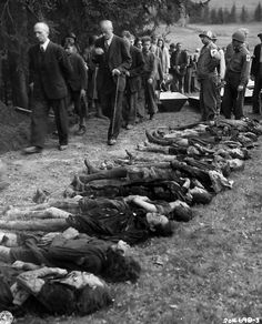 German civilians are forced to walk past bodies of 30 Jewish women starved to death by German SS troops