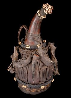Africa | Decorated gourd vessel from the Bamum/Bamoum people of  the Grassfields region in Western Cameroon | ca. 19th century | Gourd, vegetable fibers, human jaws, feathers and cowrie shells.