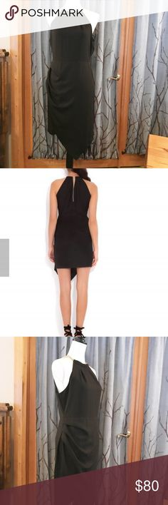 """Nwt. WISH Coast dress, size M black NWT. WISH Coast dress in black. Be the  life of the cocktail/holiday party! Features gold metal necklace threaded through front and back, wrapped front skirt with side ruching and asymmetrical hemline. Size M arm pit to arm pit 18.5"""", length 35"""" Wish Dresses"""