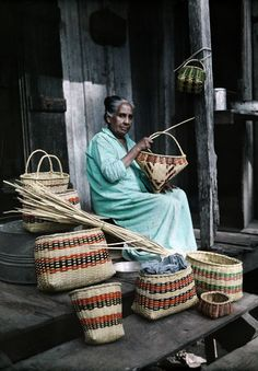 Louisiana - A Choctaw Indian woman makes baskets from palmetto leaves, near Lacombe
