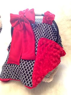 For a girl(love the red!): Car Seat Cover Red Swirl Minky with Black and White cover. $55.00, via Etsy.