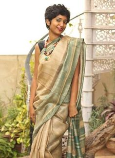 Pure gheecha silk saree , make an elegant picture wearing this saree. Blouse comes with the saree, green stripes.Dry cleaning only.