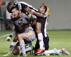 Goalkeeper Victor of Brazil's Atletico Mineiro celebrates with teammates after saving a penalty shot from Riascos of Mexico's Tijuana during their Copa Libertadores soccer match in Belo Horizonte.