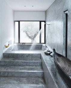 Raw industrial concrete floor and bath