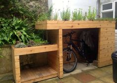 Bike shed and log store combined with the added bonus of a green roof! http://moralfibres.co.uk/green-roof-ideas and https://www.homify.co.uk/photo/439341/bike-and-log-store-with-green-roof