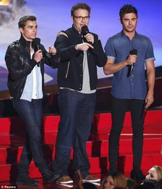Three stooges: Seth Rogen was joined by Zac Efron and Dave Franco as they presented the Best Kiss gong