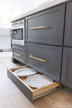 A push on the toekick with your foot reveals a hidden toekick drawer with shallo. A push on the toekick with your foot reveals a hidden toekick drawer with shallow storage space for trays and other large, hard to store kitchen items! Kitchen Cabinet Storage, Kitchen Cabinet Design, Kitchen Redo, Home Decor Kitchen, Interior Design Kitchen, Kitchen Living, Home Kitchens, Kitchen Items, Kitchen Cabinets With Drawers