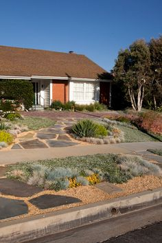 contemporary landscape by Gregory Davis & Associates - stepping stones in blvd strip