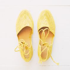 Handmade natural raffia flat that ties at the ankle in a striking yellow.  Traditional Moroccan toe shape. Made in MoroccoEuropean Sizing
