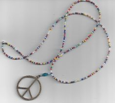 Peace necklace with multicolored small seed by RoseFireDesigns