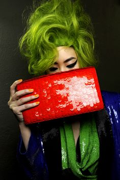 green hair and red sequin clutch by Jean Paul Gaultier