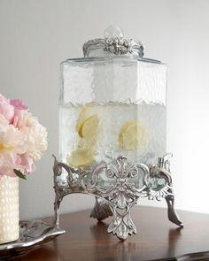 Textured glass beverage server in fleur-de-lis embellished stand