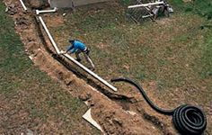 Connecting downspouts to buried drainpipes can help dry out a wet basement and soggy lawn