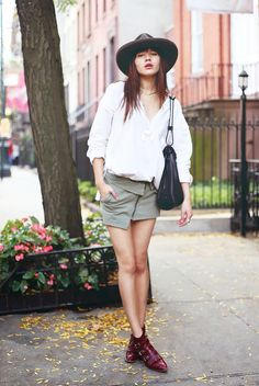 Natalie Suarez from Natalie Off Duty adds some color to her simple outfit with red fringed boots.