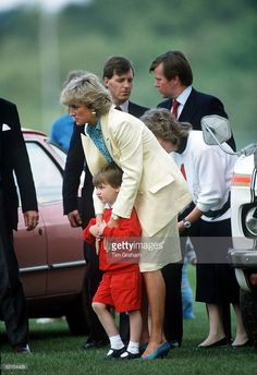 Princess Diana And Prince William Watching Polo At Smith's Lawn Polo Club. Two Police Bodyguards Stand Behind Them. Ken Wharfe At Right Wearing Red Tie.