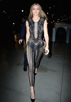Gigi Hadid wearing a Julien Macdonald jumpsuit and Kurt Geiger heels.