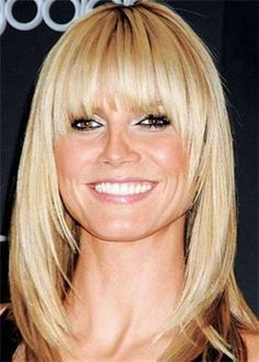 Long Bob or medium length with feathered layers framing the face with bangs lo
