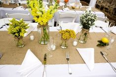 Burlap table runners and mason jars full of flowers