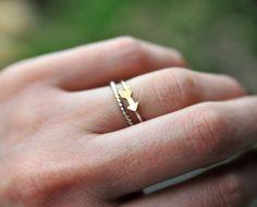 Mini Arrow Stackable Silver & Brass Ring. $46.00, via Etsy.