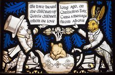 Detail, Lewis Carroll Alice in Wonderland Memorial Window at All Saint's Church in Daresbury. The Mad Hatter, the Dormouse, and the March Hare.