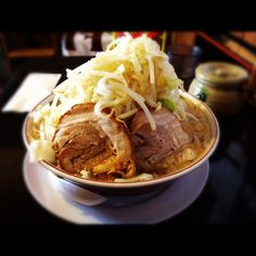 NOROSHI. Ramen is Jiro inspired system, use homemade noodles. Roast pork, you can add in one piece 10 yen up to three pieces. Vegetables have a lot riding. You eat garlic in the table equipped with your choice.