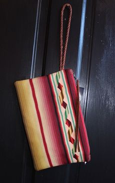 "Totem Salvaged Vintage Serape Clutch Hand braided leather wristlet 100% Fine Grain Leather YKK Zipper Closure with Leather Fringe Pull Lined with Vintage 100% Cotton Fabric Bag measures approximately 12"" X 7"". TOTeM Salvaged was introduced in 2010 by designer Stephanie Larrowe, created by utilizing salvaged vintage materials and repurposed into ""One of a Kind"" handbags, furniture and accessories. Yayagurlz"