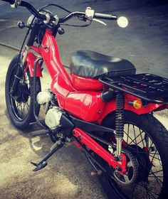 CT110 with black wheels and different handlebars