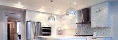 Eurofase ball shape pendants match the stylish kitchen in condominium./Contemporary pendants/Photo credit: Eurofase Lighting