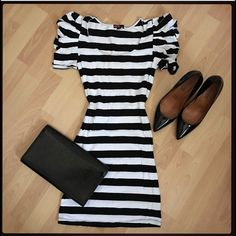 Striped black and white dress with fluffy sleeves Gently worn and washed. Cute fluffy sleeves will make you stand out! 95% cotton 5% spandex. Dress measures 31.5 inches long. Also have this in gray and black. Forever 21 Dresses Mini