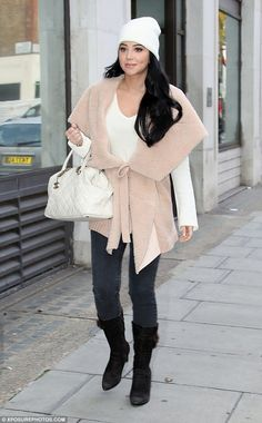 Reason to smile again: Tulisa Contostavlos  looked in high spirits as she headed to the BBC Radio One studios in London on Friday morning to co-host a show with Amplify Dot