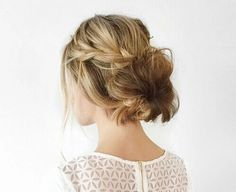 Perfect messy low bun with a loose braid. Would look pretty for any bridal or prom updo // - M